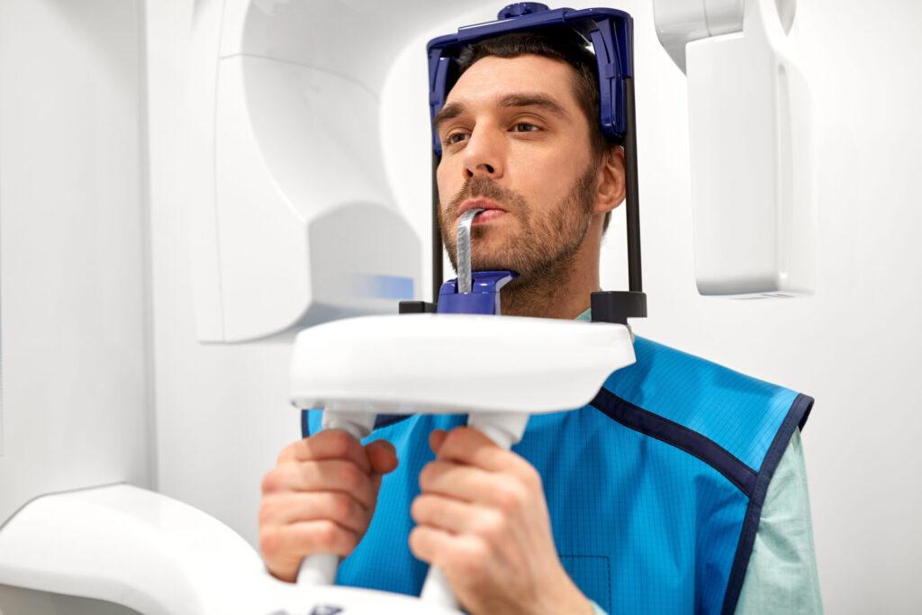 A man using the panoramic x-ray machine