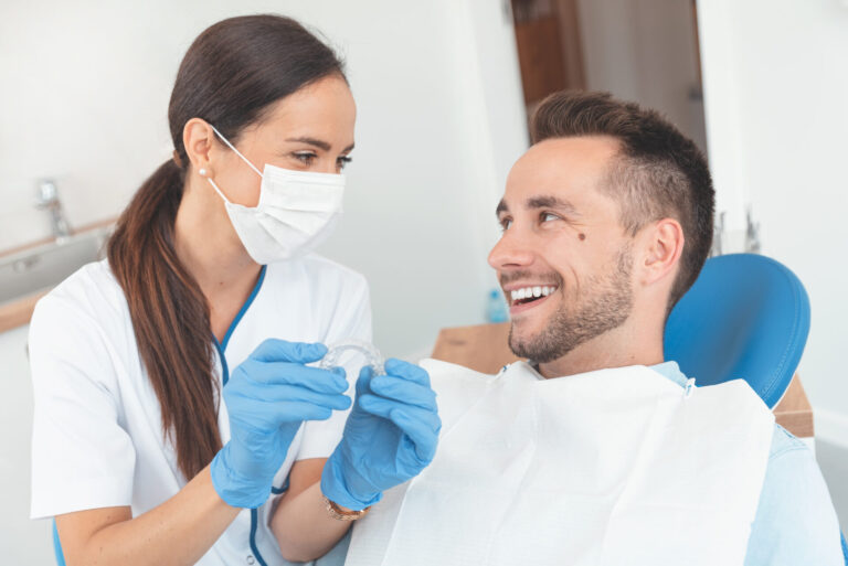 A dentist showing the invisalign to her patient